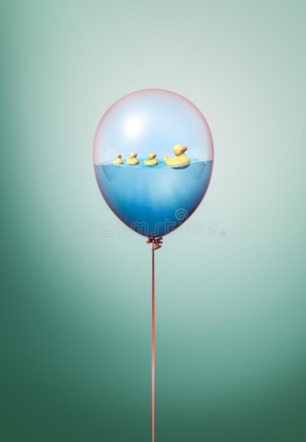Minimal balloon concept with toy duck on water. Yellow rubber duck idea on green background. Toy duck on water minimal concept inside balloon. Flying balloon stock illustration