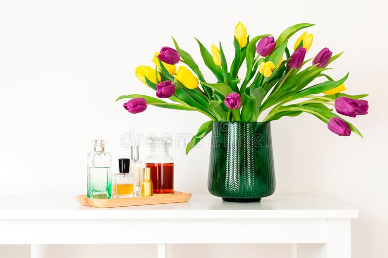 Minimal composition, scandinavian nordic hygge style, home interior, mother day - tulips in green vase royalty free stock photos