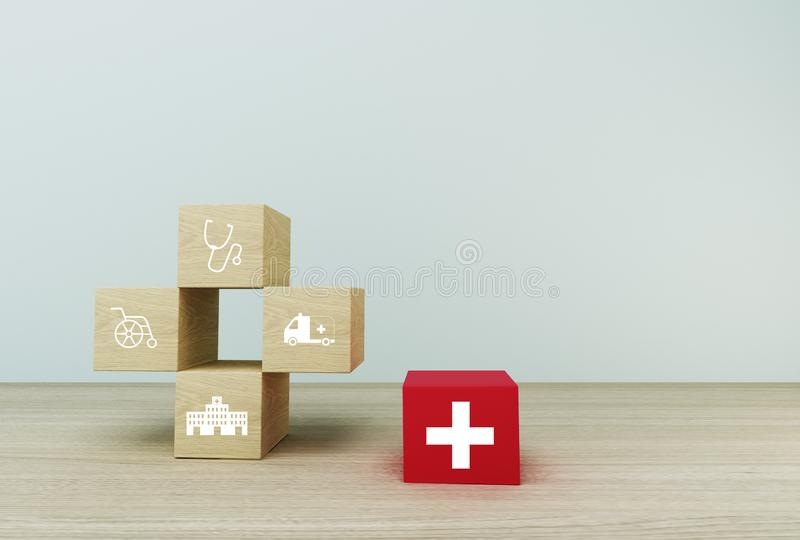 Minimal concept idea about of health and medical insurance, arranging block color stacking with icon healthcare medical on wooden. Background stock photo