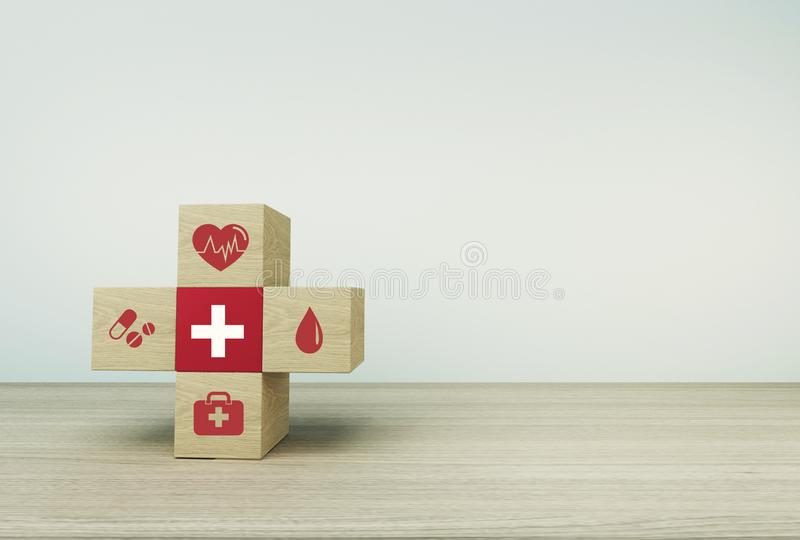 Minimal concept idea about of health and medical insurance, arranging wood block stacking with icon healthcare medical on  table b. Ackground stock photography