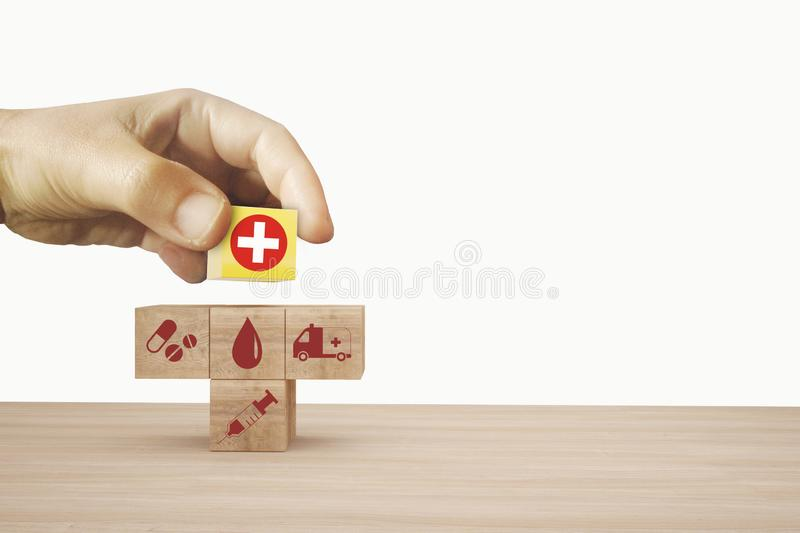 Minimal concept idea about of health and medical insurance, Hand arranging wooden block stacking with icon healthcare medical. Minimal concept idea about of stock images