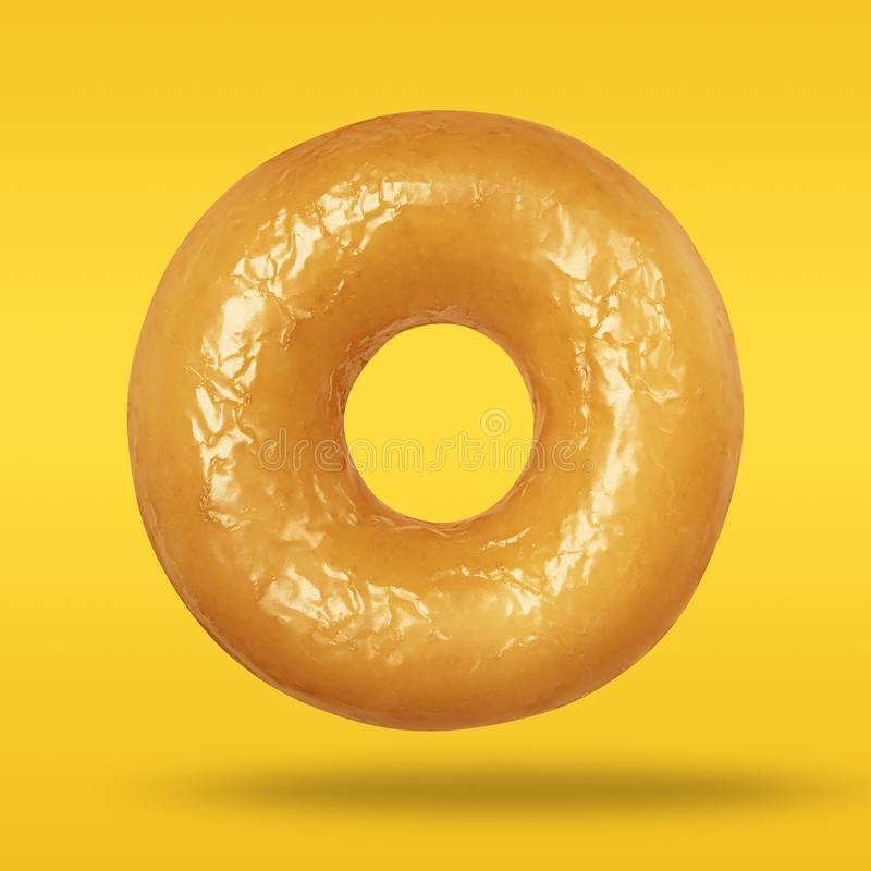 Minimal concept sweet food. Donut glazed on pastel yellow and orange background. Sweet sugar icing donut. Top view.  royalty free stock photography