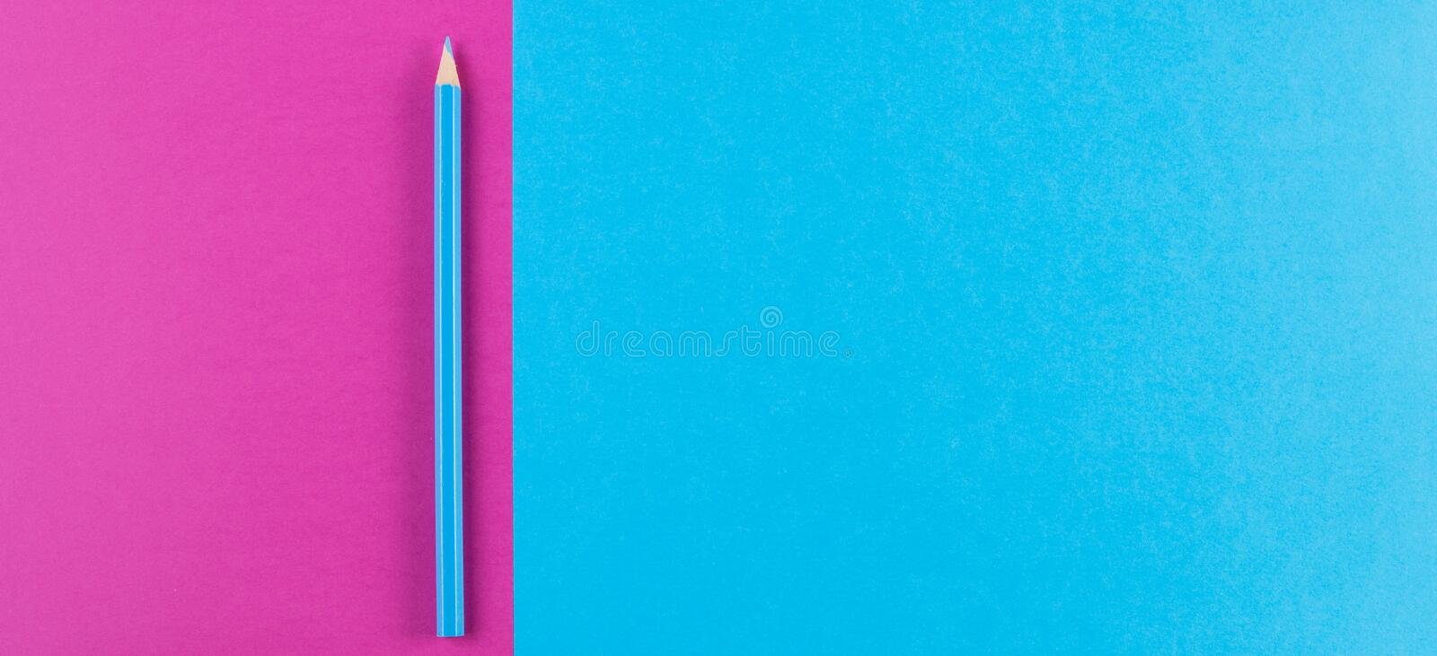 Minimal creative color papers geometry flat composition background with blue color pencil. Minimal creative color papers geometry flat lay composition banner stock photos