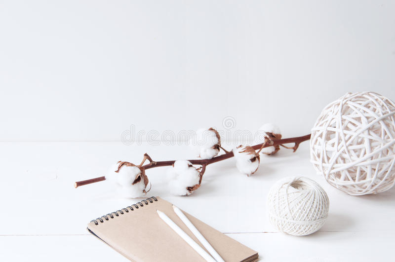 Minimal elegant composition with cotton, balls and notebook royalty free stock photos