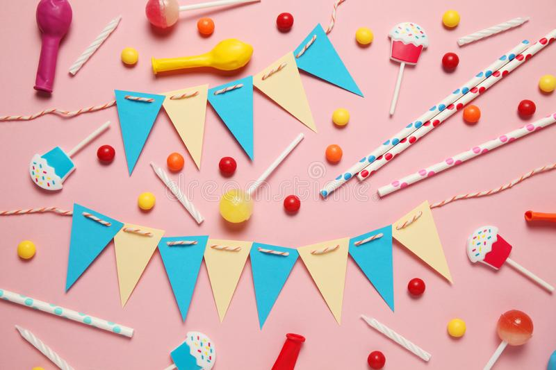 Minimal happy birthday decor for party. Sweet candy, balloons, straw royalty free stock images