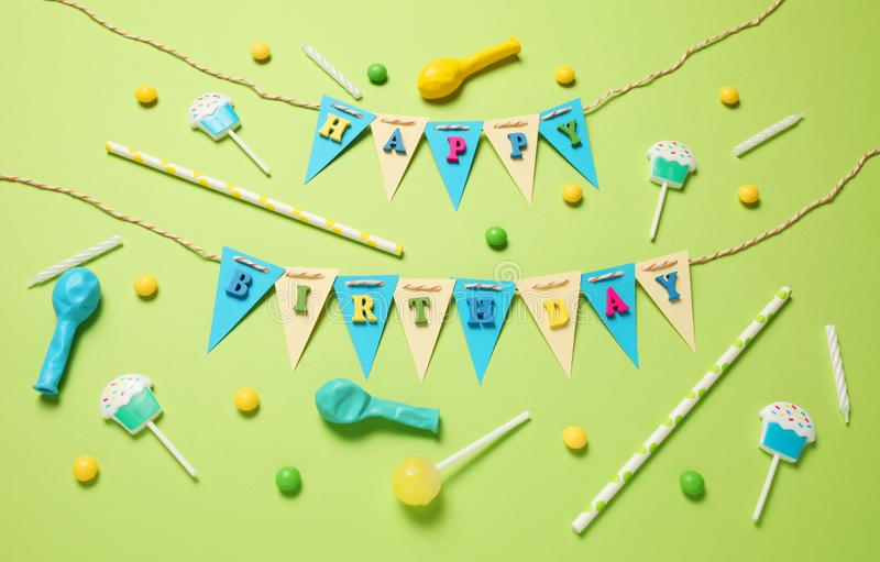 Minimal happy birthday decor for party. Sweet candy, balloons, straw royalty free stock photos