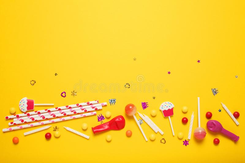 Minimal happy birthday decor for party. Sweet candy, balloons, straw. Copy space for text stock photos