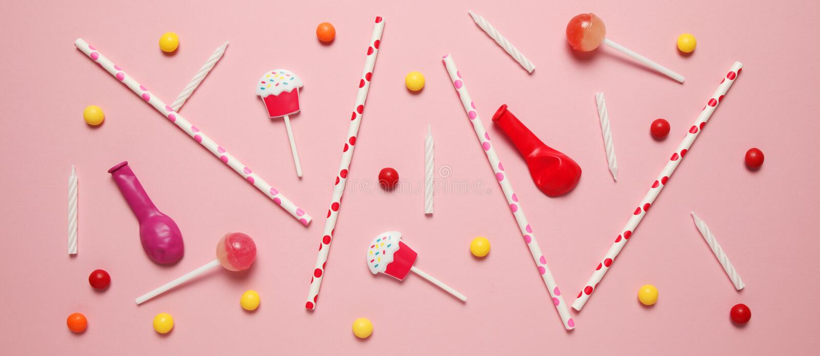 Minimal happy birthday decor for party. Sweet candy, balloons, straw stock images