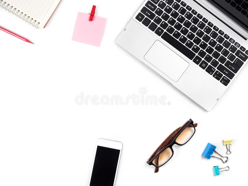 Minimal and Modern white desk and table office with laptop, glasses, smartphone and other supplies, Top view with space for copy stock photography