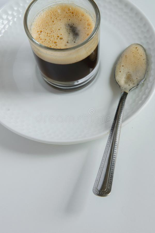 Minimal refreshment coffee break. Iced coffee on table, space for text royalty free stock images