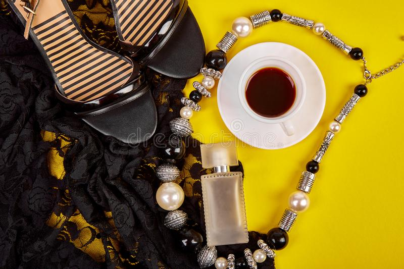 Minimal set of women accessories with cup of coffee stock images