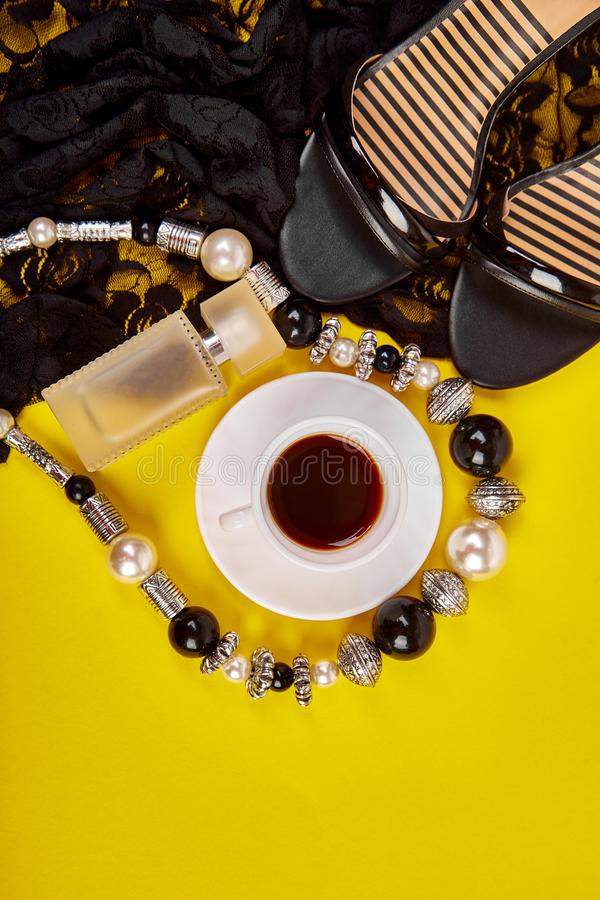 Minimal set of women accessories with cup of coffee stock photo