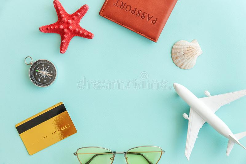 Minimal simple flat lay travel adventure trip concept on blue pastel colourful trendy modern background. Vacation travel adventure trip concept. Minimal simple stock image