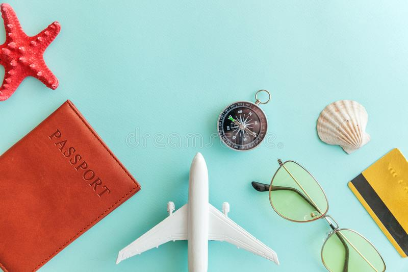 Minimal simple flat lay travel adventure trip concept on blue pastel colourful trendy modern background. Vacation travel adventure trip concept. Minimal simple royalty free stock photos