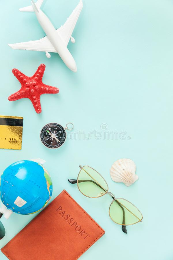 Minimal simple flat lay travel adventure trip concept on blue pastel colourful trendy modern background. Vacation travel adventure trip concept. Minimal simple royalty free stock photo
