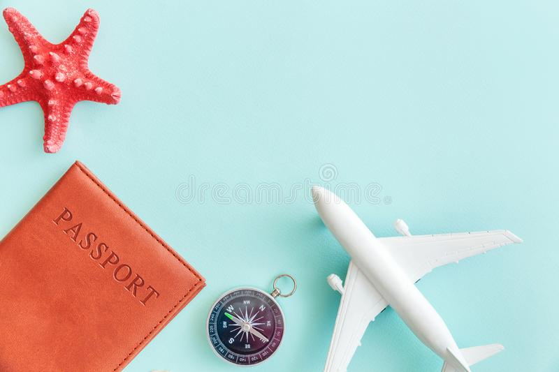 Minimal simple flat lay travel adventure trip concept on blue pastel colourful trendy modern background. Vacation travel adventure trip concept. Minimal simple stock photography