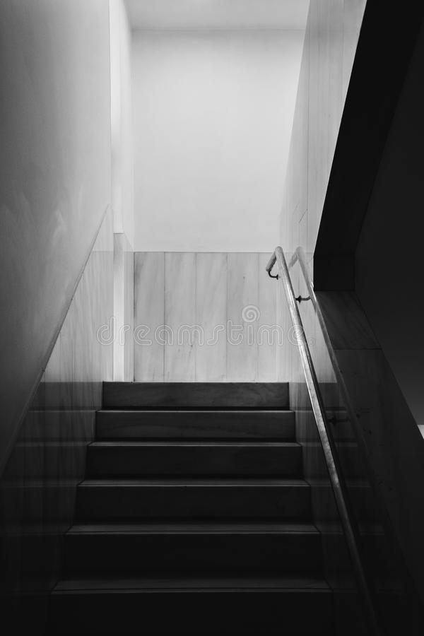 Minimal staircase on black and white stock photo