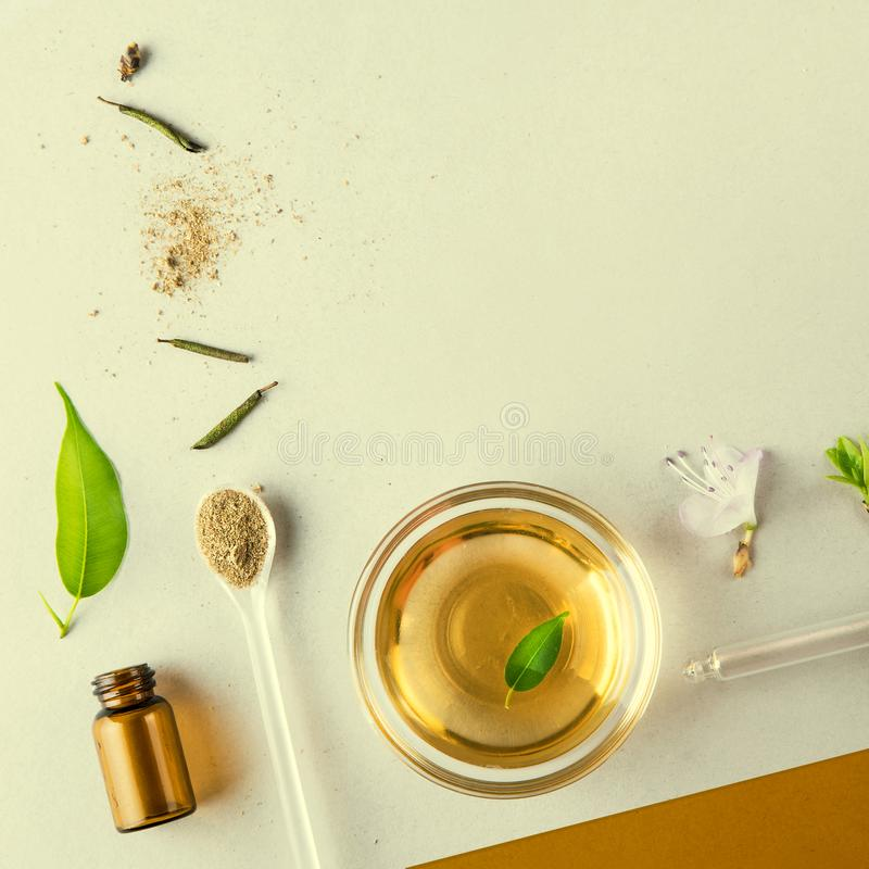 Minimal style. A cup, natural oil, a pipette, vegetable ingredients. Natural cosmetics, handmade skin care. Flat lay. The minimal style. Natural cosmetics stock images