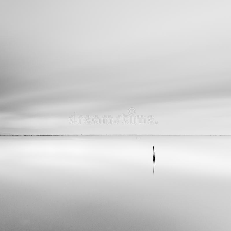 Minimal waterscape with pillar royalty free stock photos