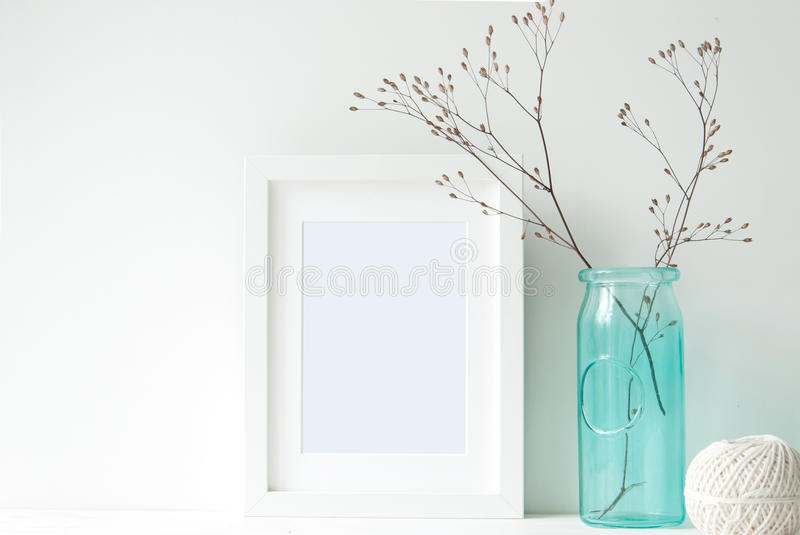Minimal white frame with turquoise vase royalty free stock images