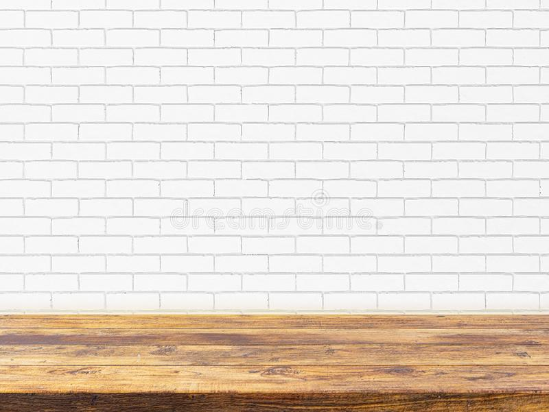 Minimal Wood table top on white brick wall background Ready used as display or montage products design mockup stock photo
