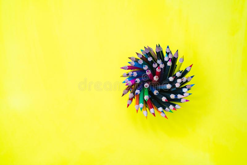 Minimal work space Colorful background with many crayons, Top vi stock photo