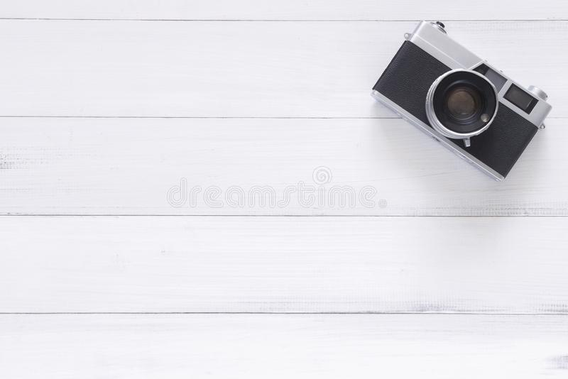 Minimal work space - Creative flat lay photo of workspace desk. Office desk wooden table with old camera. Top view with copy space. Top view of old camera over stock photography