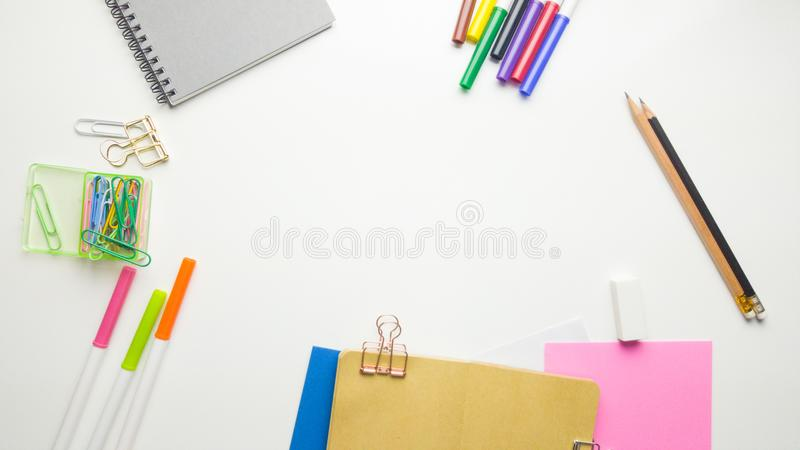 Creative flat lay photo of workspace desk with sketchbook and wooden pencil on copy space white background. Minimal work space - Creative flat lay photo of royalty free stock photo