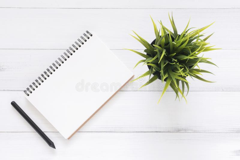 Creative flat lay photo of workspace desk. White office desk wooden table background with open mock up notebooks and pens. Minimal work space - Creative flat stock photography