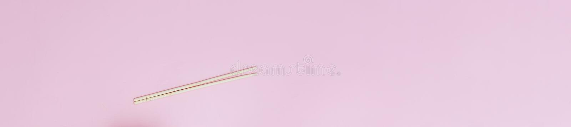 Minimalism chopsticks flatlay on pink background long banner flatlay royalty free stock photography