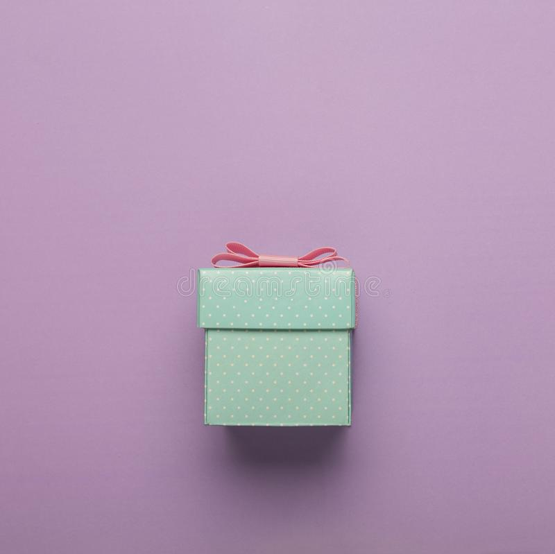 MINIMALISM. gift box, pink bow, holiday, free space for text. copy space. esign, flatlay, greeting, stock images