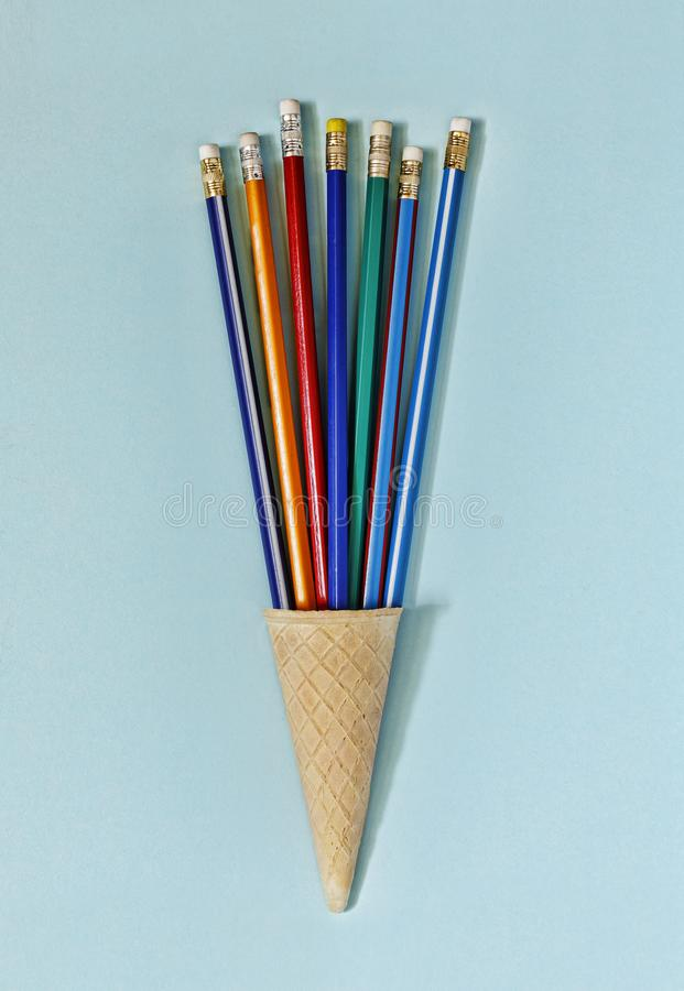 Minimalism. Ice cream cone, art, colorful pencils,fun, business concept. top view. copy space stock photo