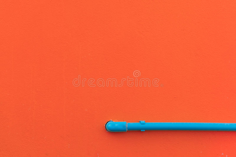Minimalism style, Blue water tube on the wall. stock photo