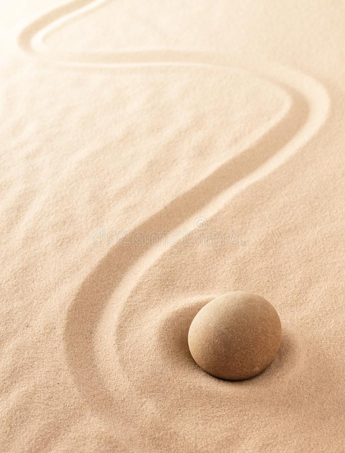 Minimalism zen sand and stone meditation garden. Spa wellness or yoga background with copy space royalty free stock image