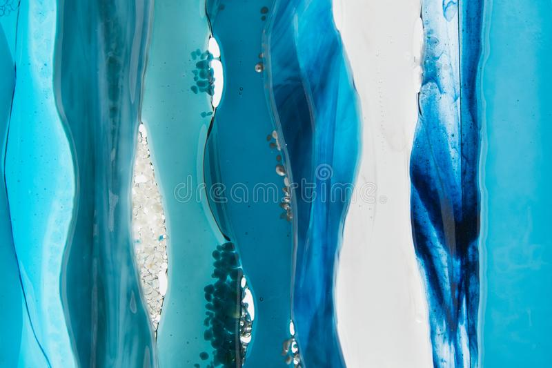 Minimalist abstract background - sea waves in different shades of blue royalty free stock photography