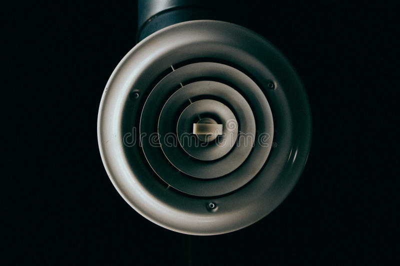 Minimalist Air Vent. A focused, minimalist shot of an air vent against a flat black background stock photos