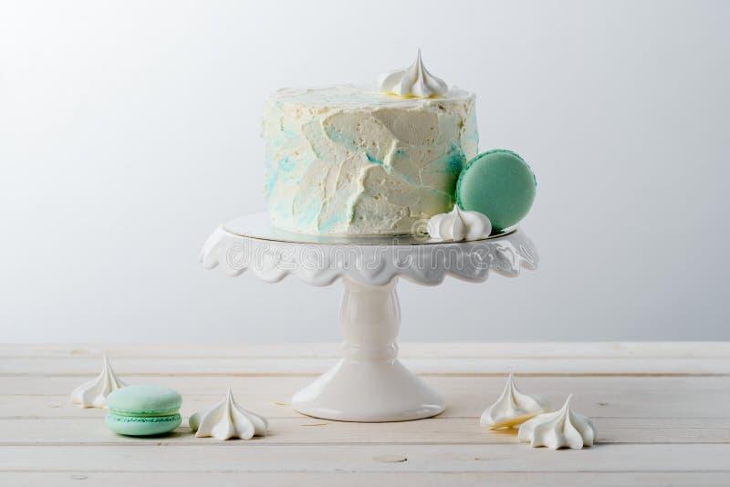 Minimalist cake, macaroni and meringues royalty free stock photo