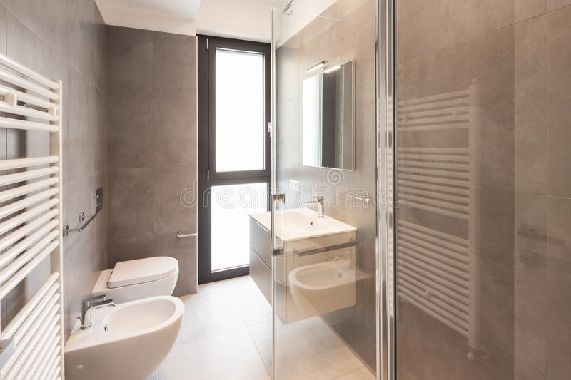 Minimalist modern bathroom with large tiles royalty free stock photography
