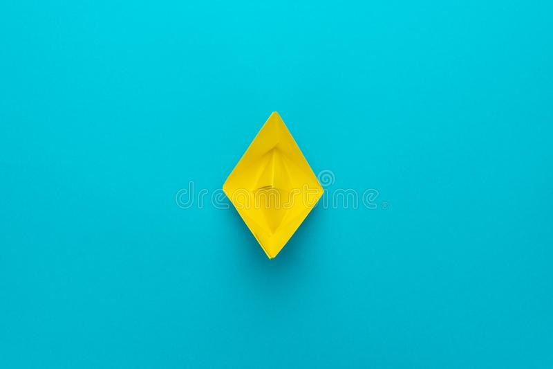 Minimalist photo of yellow paper ship with copy space. loneliness concept stock photos
