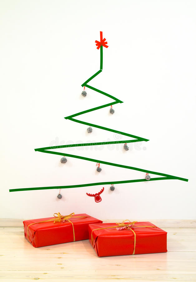 Minimalist style geometric duct tape Christmas tree with presents royalty free stock images
