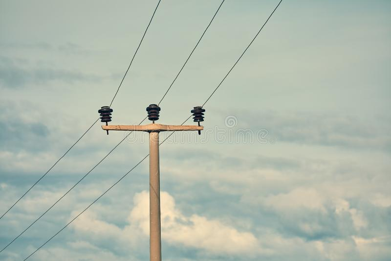 High voltage power electric pole, power lines and fuses royalty free stock image