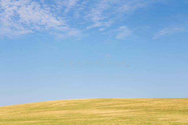 Minimalist view of landscape with meadow and sky stock image