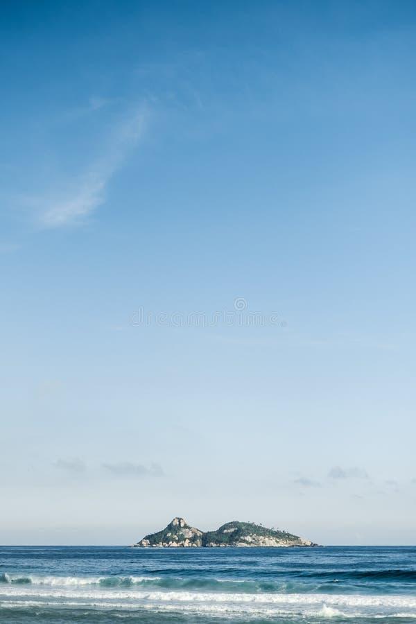 Minimalist view of Tijucas Island seen from the Barra da Tijuca beach on a beatiful afternoon, Rio de Janeiro stock photos