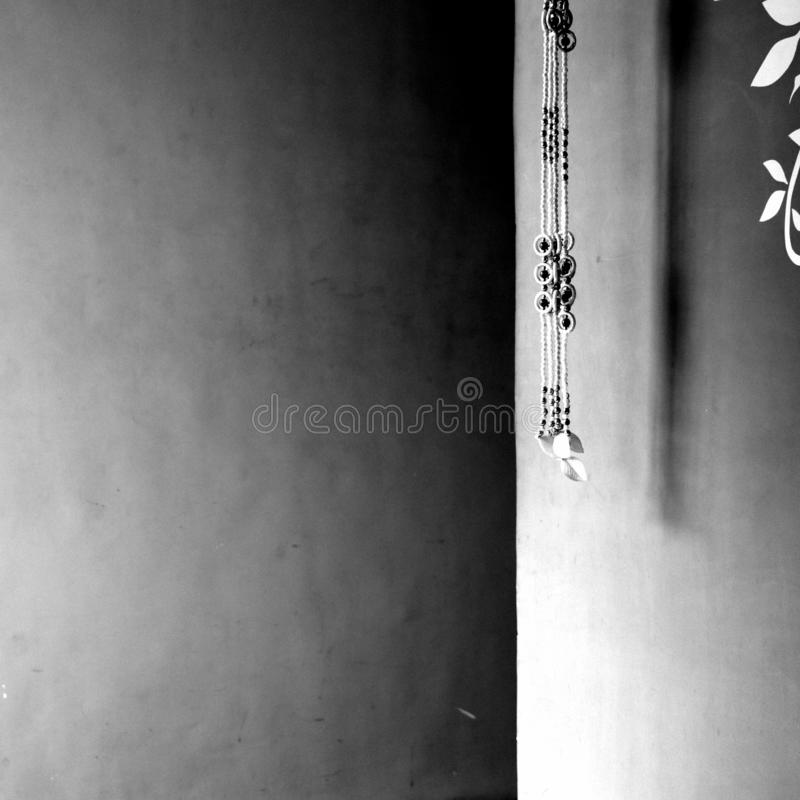Minimalistic in Black and White. Minimalistic black white room wall decor painting flower jewelry beautiful light shadow object home art wallpaper background stock images