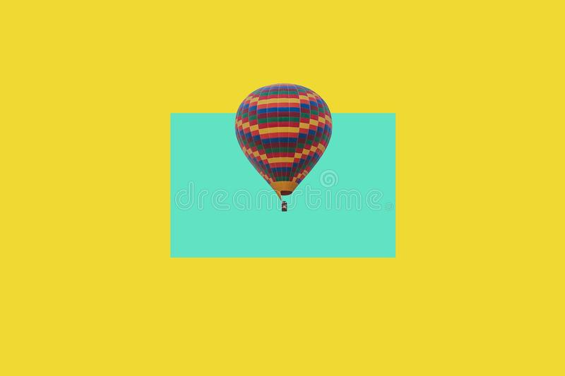 Minimalistic concept flying air ball on a colored background.  royalty free stock photography