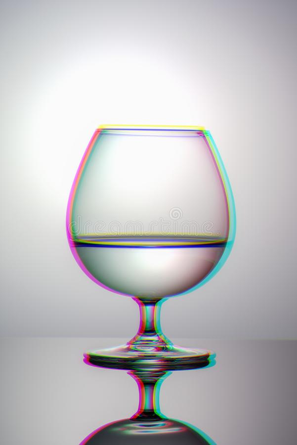 Minimalistic image of a glass Cup with water vertical view, anaglyph and glitch effect. Minimalistic image of glass Cup with water vertical view, anaglyph and stock images