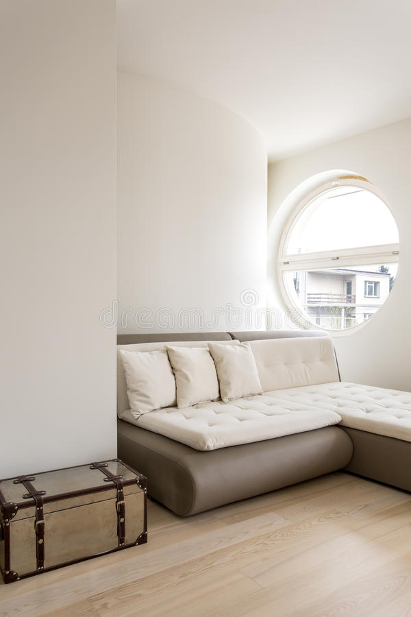 Minimalistic interior with a sleeper sectional stock photo