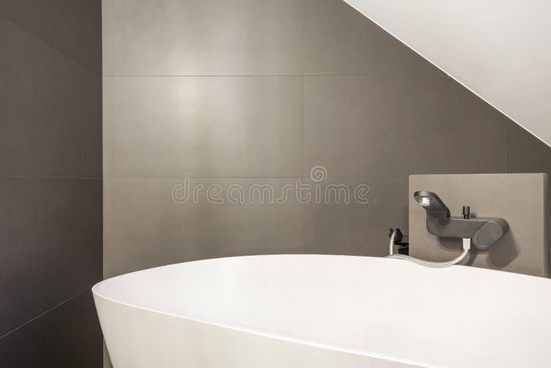Minimalistic oval bathtub royalty free stock photography