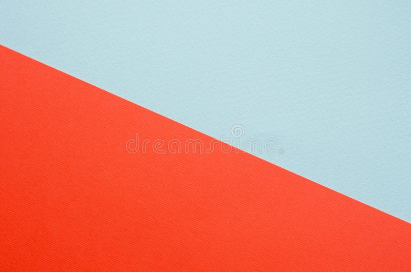 Minimalistic paper background in green and orange. Minimalistic paper background of green or mint color and orange royalty free stock image
