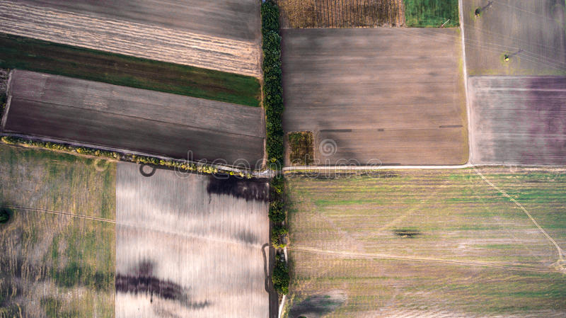 Minimalistic photograph of the beveled field, taken from the air. royalty free stock photos